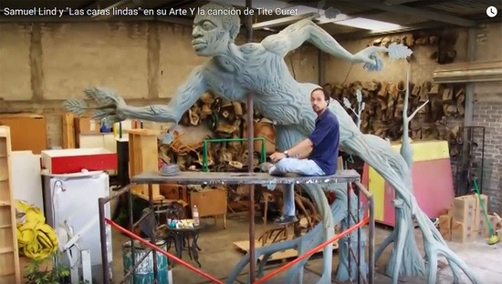 Samuel Lind in his studio with his Osain sculpture