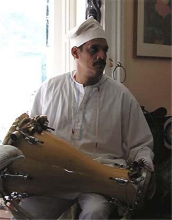 Nadhiyr Velez playing bata drum