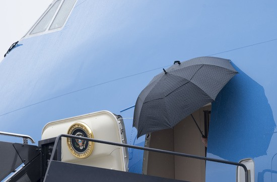 US President Donald Trump holds an umbrella as he disembarks from Air Force One upon arrival at Newark Liberty International Airport in Newark, New Jersey, July 14, 2017, following a 2-day trip to Paris for Bastille Day. / AFP PHOTO / SAUL LOEB        (Photo credit should read SAUL LOEB/AFP/Getty Images)