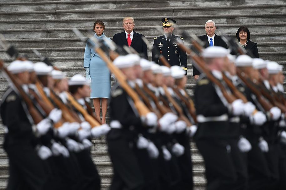 L-R: First Lady of the US Melania Trump, President Donald Trump, US Army Maj. General Bradley Becker, Vice President Mike Pence and Karen Pence look on at the start of the inaugural parade at the US Capitol January 20, 2017 in Washington, DC. / AFP / Robyn BECK        (Photo credit should read ROBYN BECK/AFP/Getty Images)