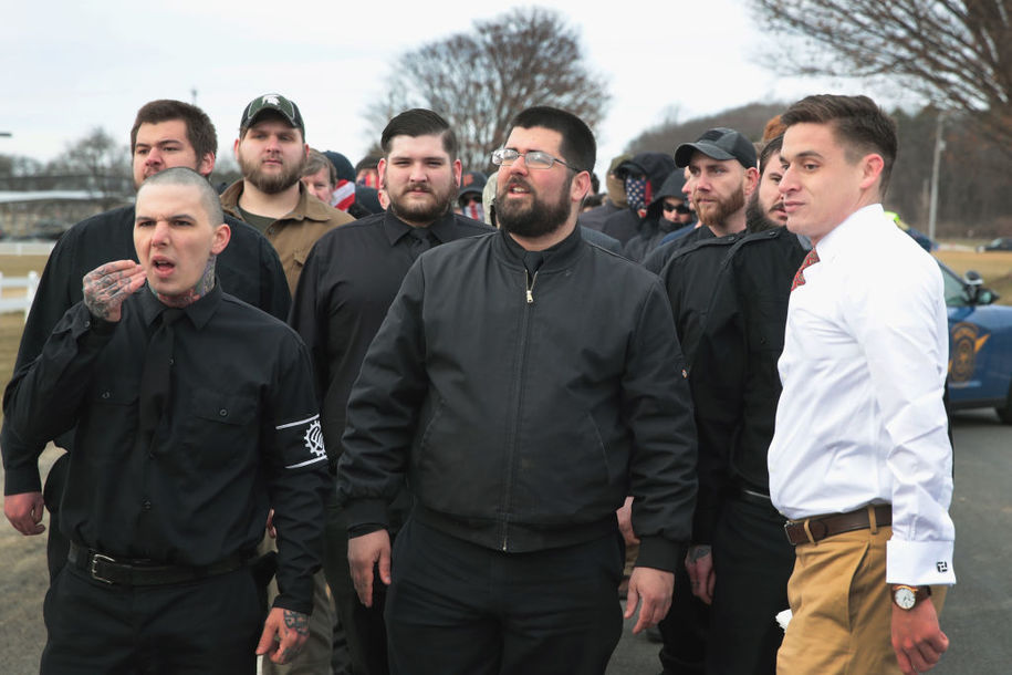 EAST LANSING, MI - MARCH 05:  White nationalist Matthew Heimbach (C) arrives with other alt-right advocates to attend a speech by white nationalist Richard Spencer on March 5, 2018 in East Lansing, Michigan. Spencer was granted permission to speak after suing the university which is currently on spring break.  (Photo by Scott Olson/Getty Images)