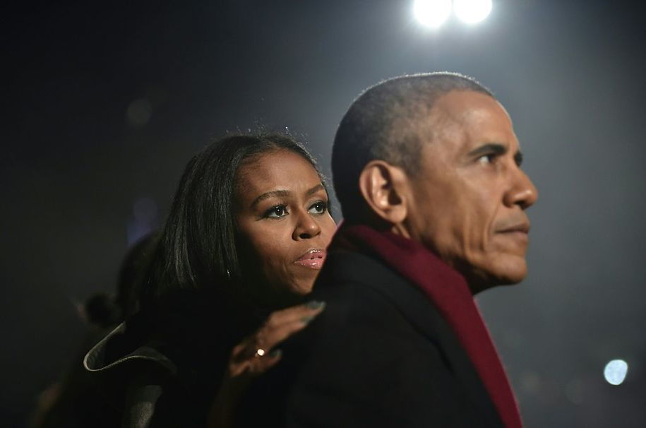 US President Barack Obama and First Lady Michelle Obama attend the National Christmas Tree Lighting on the Ellipse of the National Mall in Washington on December 1, 2016.  / AFP / Nicholas Kamm        (Photo credit should read NICHOLAS KAMM/AFP/Getty Images)