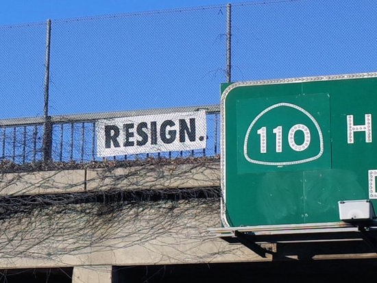 Resign sign over 110 fwy