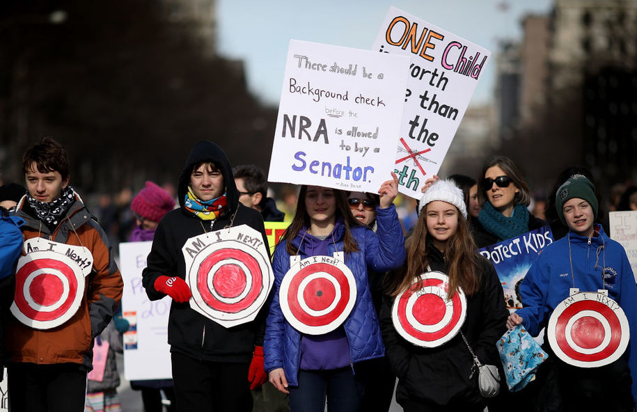 WASHINGTON, DC - MARCH 24:  Students from Centreville, Virginia wear targets on their chests as they arrive for the March for Our Lives rally March 24, 2018 in Washington, DC. Hundreds of thousands of demonstrators, including students, teachers, and parents are expected to gather for the anti-gun violence rally, spurred largely by the shooting that took place on Valentine's Day at Marjory Stoneman Douglas High School in Parkland, Florida where 17 people died.  (Photo by Win McNamee/Getty Images)