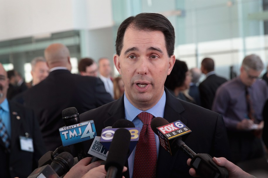 A defensive Scott Walker insists signing Wisconsin power grab wouldn't just be dirty partisanship