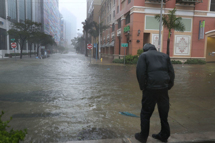 MIAMI, FL - SEPTEMBER 10: A person looks on at a flooded street in the Brickell area of downtown as Hurricane Irma passes through on September 10, 2017 in Miami, Florida. Hurricane Irma made landfall in the Florida Keys as a Category 4 storm on Sunday, lashing the state with 130 mph winds as it moves up the coast. (Photo by Joe Raedle/Getty Images)