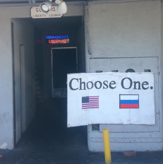 Choose One sign with US and Russian flags outside of Rohrabacher Campaign Headquarters