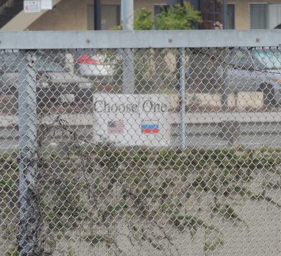 Choose One. sign with US and Russian Federation flags across 55 freeway from Rohrabacher campaign HQ.