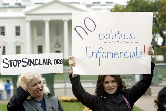 WASHINGTON - OCTOBER 22: (L-R) Protesters Madonna Brennan of Gambrills, Maryland and Clarissa Kornell hold signs during a protest rally against Sinclair Broadcasting in Lafayette Park near the White House October 22, 2004 in Washington, DC. Sinclair had planed to air a documentary strongly critical of the Democratic Presidential nominee John Kerry's Vietnam War record just ahead of the November 2 presidential election, but now says it will air only some segments. (Photo by Matthew Cavanaugh/Getty Images)