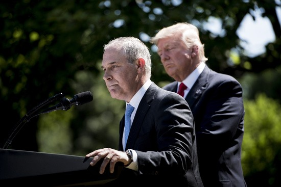 "US President Donald Trump (L) listens to Environmental Protection Agency Administrator Scott Pruitt speak after announcing the US will withdraw from the Paris accord in the Rose Garden of the White House on June 1, 2017 in Washington, DC..""As of today, the United States will cease all implementation of the non-binding Paris accord and the draconian financial and economic burdens the agreement imposes on our country,"" Trump said. / AFP PHOTO / Brendan Smialowski        (Photo credit should read BRENDAN SMIALOWSKI/AFP/Getty Images)"