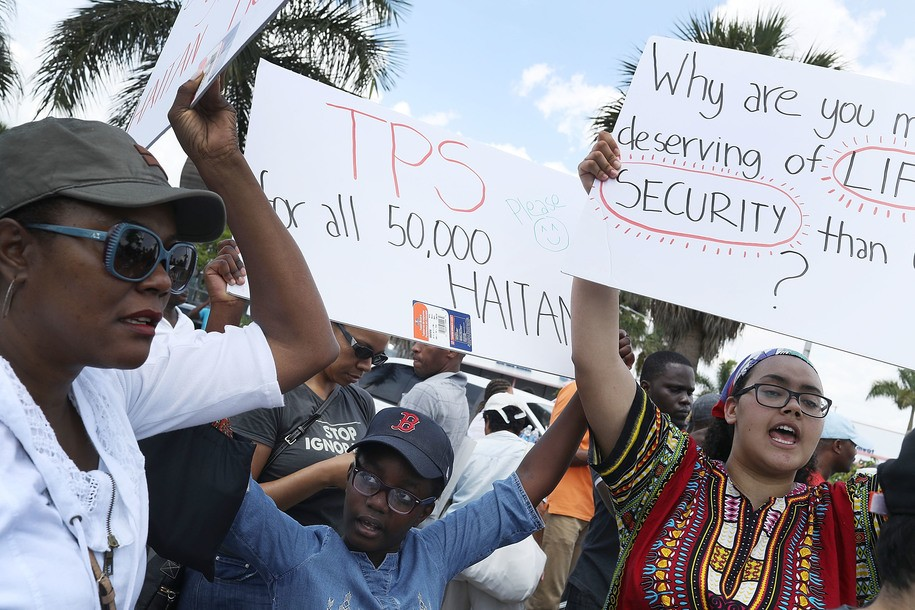 MIAMI, FL - MAY 13: People protest the possibility that the Trump administration may overturn the Temporary Protected Status for Haitians in front of the U.S. Citizenship and Immigration Services office on May 13, 2017 in Miami, Florida. 50,000 Haitians have been eligible for TPS and now the Trump administration has until May 23 to make a decision on extending TPS for Haitians or allowing it to expire on July 22 which would mean possibly deportation for the current TPS holders. (Photo by Joe Raedle/Getty Images)