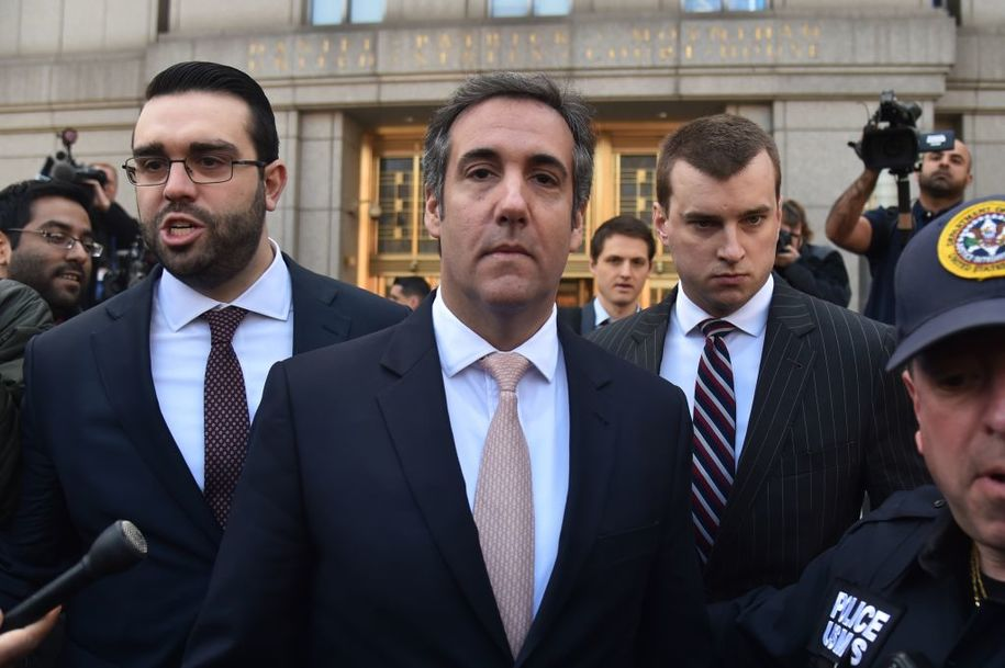 "US President Donald Trump's personal lawyer Michael Cohen(C) leaves the US Courthouse in New York on April 26, 2018. - US President Donald Trump acknowledged on Thursday that his personal lawyer, Michael Cohen, represented him in a ""deal"" involving porn star Stormy Daniels. Trump had previously denied knowledge of a $130,000 payment Cohen made to Daniels that she claims was to prevent her from talking about their alleged 2006 affair.Trump, in a wide-ranging telephone interview with ""Fox and Friends,"" admitted for the first time that Cohen represented him in a ""deal"" with Daniels, who has filed a lawsuit seeking to have the ""hush agreement"" negotiated by Cohen thrown out. (Photo by HECTOR RETAMAL / AFP)        (Photo credit should read HECTOR RETAMAL/AFP/Getty Images)"