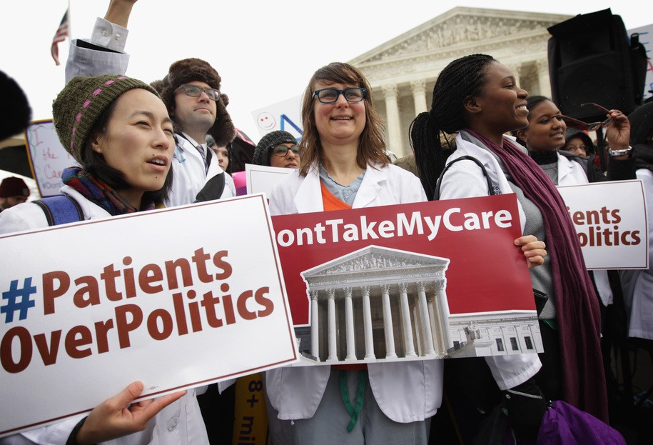 WASHINGTON, DC - MARCH 04: Supporters of the Affordable Care Act gather in front of the U.S Supreme Court during a rally March 4, 2015 in Washington, DC. The Supreme Court was scheduled to hear oral arguments in the case of King v. Burwell that could determine the fate of health care subsidies for as many as eight million people. (Photo by Alex Wong/Getty Images)