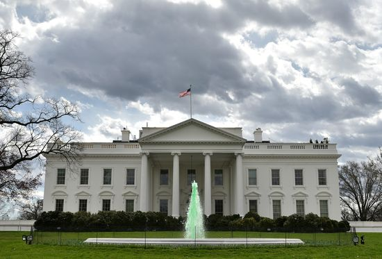 The fountain on the North Lawn of the White House is colored green in celebration of Saint Patrick's Day on March 17, 2016 in Washington, DC. / AFP PHOTO / Mandel Ngan        (Photo credit should read MANDEL NGAN/AFP/Getty Images)