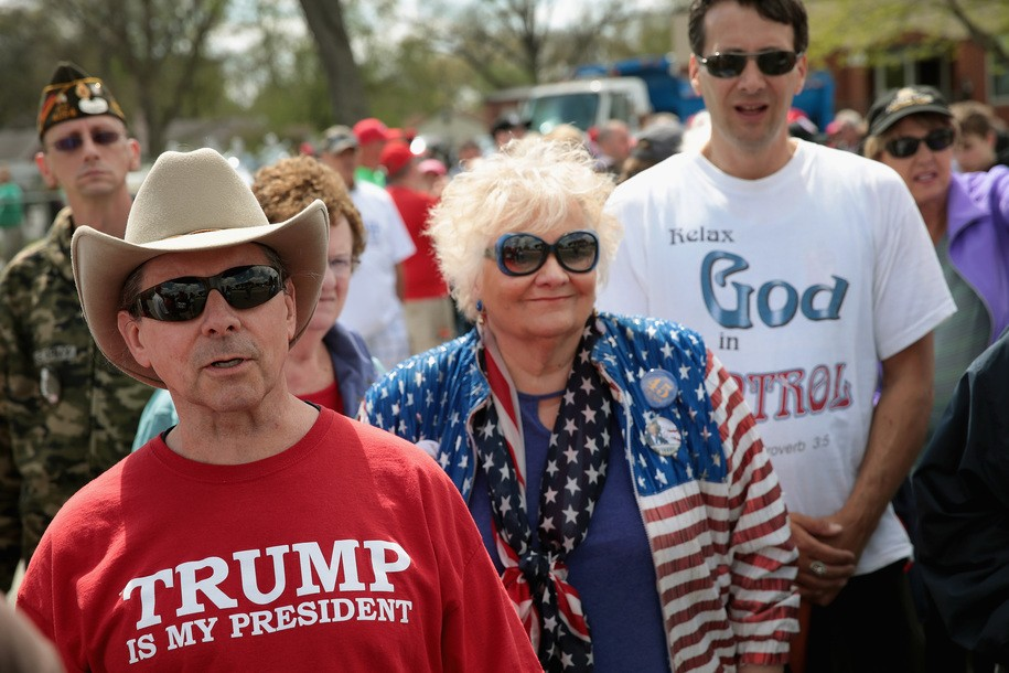 ELKHART, IN - MAY 10:  Supporters wait in line to attend a campaign rally with President Donald Trump on May 10, 2018 in Elkhart, Indiana. The line to enter the event, which has a 7,500-person capacity, circled the block.   (Photo by Scott Olson/Getty Images)