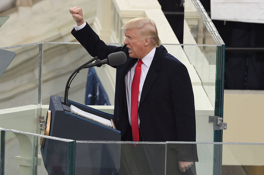 TOPSHOT - US President Donald Trump salutes the crowd after the swearing-in ceremony as 45th President of the USA in front of the Capitol in Washington on January 20, 2017.  / AFP / Timothy A. CLARY        (Photo credit should read TIMOTHY A. CLARY/AFP/Getty Images)