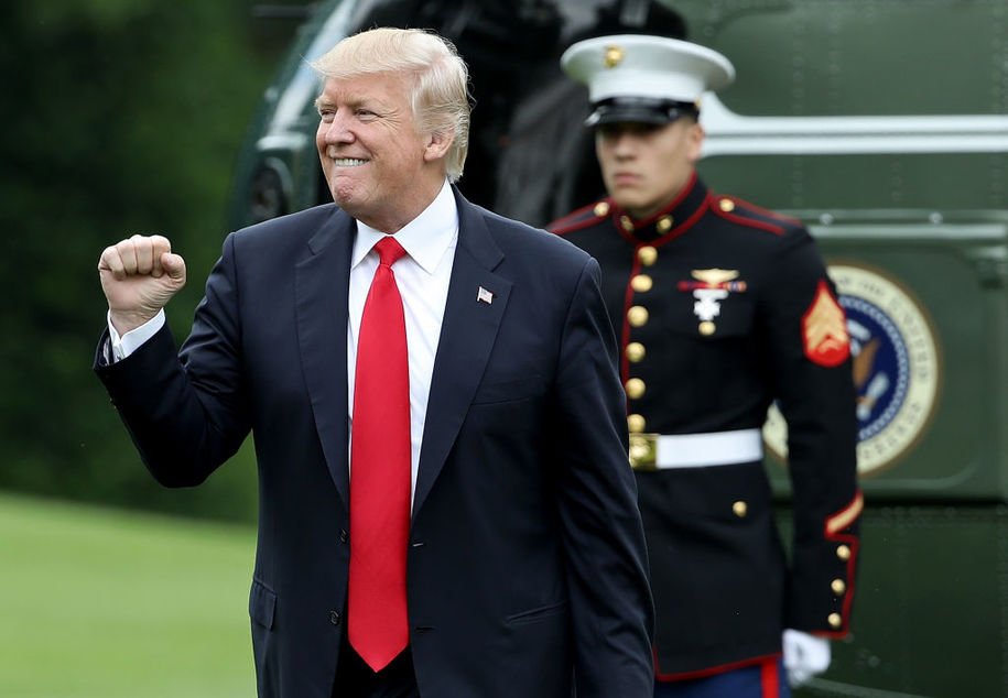 WASHINGTON, DC - JUNE 07: U.S. President Donald Trump pumps his fist as he returns to the White House June 7, 2017 in Washington, DC. Trump traveled to Cincinnati today to address his administration's infrastructure plan. (Photo by Win McNamee/Getty Images)