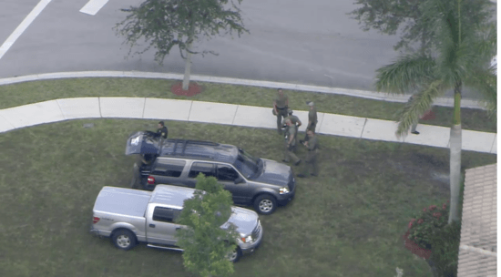 Overhead view of police gathered near David Hogg