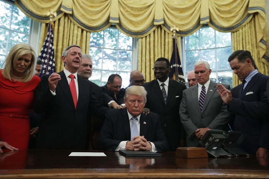 WASHINGTON, DC - SEPTEMBER 01:  U.S. President Donald Trump, Vice President Mike Pence and faith leaders say a prayer during the signing of a proclamation in the Oval Office of the White House September 1, 2017 in Washington, DC. President Trump signed a proclamation to declare this Sunday as a National Day of Prayer for people affected by Hurricane Harvey.  (Photo by Alex Wong/Getty Images)