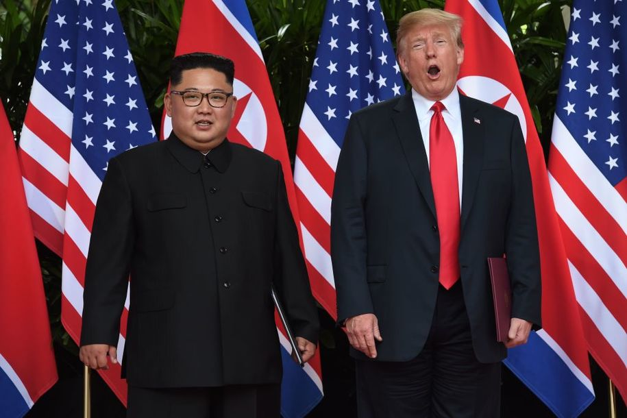 North Korea's leader Kim Jong Un (L) poses with US President Donald Trump (R) after taking part in a signing ceremony at the end of their historic US-North Korea summit, at the Capella Hotel on Sentosa island in Singapore on June 12, 2018. - Donald Trump and Kim Jong Un became on June 12 the first sitting US and North Korean leaders to meet, shake hands and negotiate to end a decades-old nuclear stand-off. (Photo by Anthony WALLACE / POOL / AFP) (Photo credit should read ANTHONY WALLACE/AFP/Getty Images)