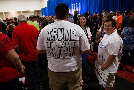GREEN BAY, WI - AUGUST 05: (EDITORS NOTE: Image contains profanity.) Supporters wait for Republican presidential candidate Donald Trump to speak at a rally in Green Bay, Wisconsin on August 5, 2016 in Green Bay, Wisconsin. (Photo by Darren Hauck/Getty Images)