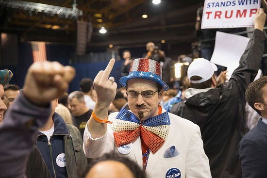 CHICAGO, IL - MARCH 11: Demonstrators clash with supporters after it was announced that a rally with Republican presidential candidate Donald Trump at the University of Illinois at Chicago would be postponed on March 11, 2016 in Chicago, Illinois. Organizers postponed the rally citing safety reasons after hundreds of demonstrators were ticketed for the event. (Photo by Scott Olson/Getty Images)