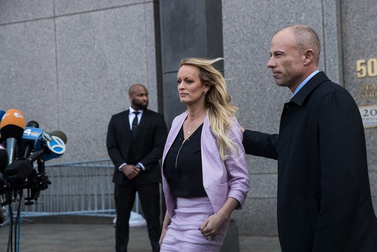 NEW YORK, NY - APRIL 16: (L to R) Adult film actress Stormy Daniels (Stephanie Clifford) and Michael Avenatti, attorney for Stormy Daniels, exit the courthouse and speak to the media as they exit the United States District Court Southern District of New York for a hearing related to Michael Cohen, President Trump's longtime personal attorney and confidante, April 16, 2018 in New York City. Cohen and lawyers representing President Trump are asking the court to block Justice Department officials from reading documents and materials related to Cohen's relationship with President Trump that they believe should be protected by attorney-client privilege. Officials with the FBI, armed with a search warrant, raided Cohen's office and two private residences last week. (Photo by Drew Angerer/Getty Images)