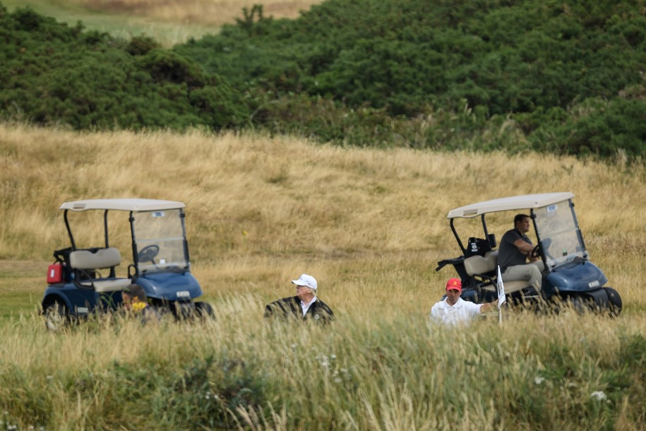 TURNBERRY, UNITED KINGDOM - JULY 14:  U.S. President Donald Trump, wearing a hat with Trump and USA displayed on it, plays golf at Trump Turnberry Luxury Collection Resort during the President's first official visit to the United Kingdom on July 14, 2018 in Turnberry, Scotland. The President of the United States and First Lady, Melania Trump on their first official visit to the UK after yesterday's meetings with the Prime Minister and the Queen is in Scotland for private weekend stay at his Turnberry.  (Photo by Leon Neal/Getty Images)