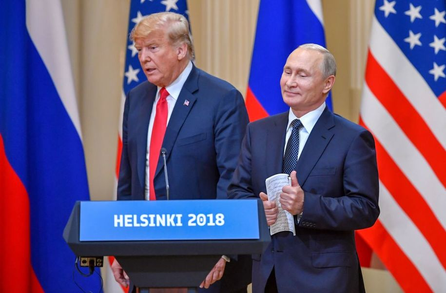 "US President Donald Trump (L) and Russia's President Vladimir Putin arrive to attend a joint press conference after a meeting at the Presidential Palace in Helsinki, on July 16, 2018. - The US and Russian leaders opened an historic summit in Helsinki, with Donald Trump promising an ""extraordinary relationship"" and Vladimir Putin saying it was high time to thrash out disputes around the world. (Photo by Yuri KADOBNOV / AFP)        (Photo credit should read YURI KADOBNOV/AFP/Getty Images)"