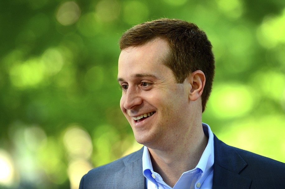 Ninth Congressional district Democratic candidate Dan McCready smiles as he speaks with U.S. Rep. Alma Adams outside Eastover Elementary School in Charlotte, N.C., Tuesday, May 8, 2018. . McCready, handily defeated 2016 party nominee Christian Cano in Tuesday's Democratic primary. (Jeff Siner/The Charlotte Observer via AP)