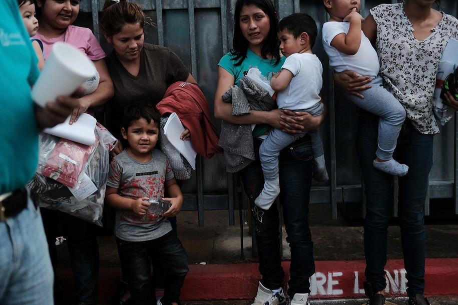 MCALLEN, TX - JUNE 22: Dozens of women and their children, many fleeing poverty and violence in Honduras, Guatamala and El Salvador, arrive at a bus station following release from Customs and Border Protection on June 22, 2018 in McAllen, Texas. Once families and individuals are released and given a court hearing date they are brought to the Catholic Charities Humanitarian Respite Center to rest, clean up, enjoy a meal and to get guidance to their next destination. Before President Donald Trump signed an executive order Wednesday that halts the practice of separating families who are seeking asylum, over 2,300 immigrant children had been separated from their parents in the zero-tolerance policy for border crossers. (Photo by Spencer Platt/Getty Images)