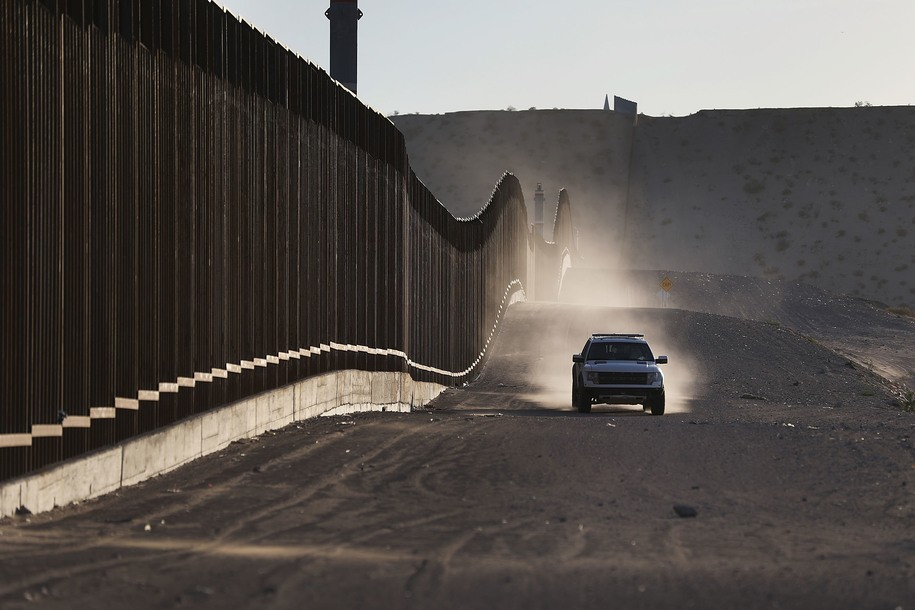 SUNLAND PARK, NM - JUNE 24: A U.S. Border Patrol vehicle drives along the U.S./Mexico border fence on June 24, 2018 in Sunland Park, New Mexico. The Trump administration's 'zero tolerance' policy on immigration has created confusion for those seeking to immigrate to the United States. (Photo by Joe Raedle/Getty Images)