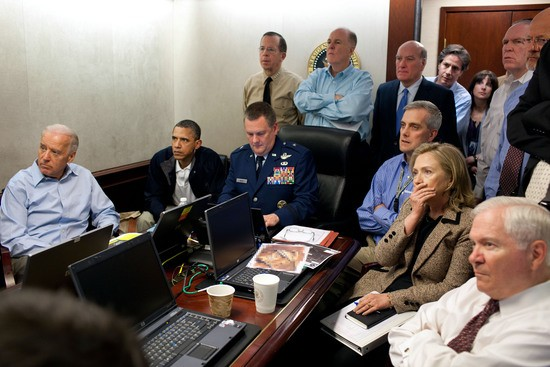 President Barack Obama and Vice President Joe Biden, along with with members of the national security team, receive an update on the mission against Osama bin Laden in the Situation Room of the White House, May 1, 2011. Please note: a classified document seen in this photograph has been obscured. (Official White House Photo by Pete Souza)..This official White House photograph is being made available only for publication by news organizations and/or for personal use printing by the subject(s) of the photograph. The photograph may not be manipulated in any way and may not be used in commercial or political materials, advertisements, emails, products, promotions that in any way suggests approval or endorsement of the President, the First Family, or the White House.