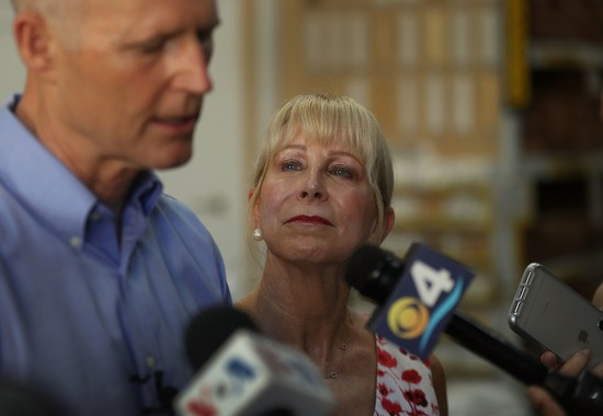 MIAMI, FL - JUNE 04:  First Lady Ann Scott listens as Florida Governor Rick Scott speaks to the media during a visit to the Shell Lumber and Hardware store on June 4, 2018 in Miami, Florida. The governor visited the store to highlight the disaster preparedness sales tax holiday running now through June 7th and to encourage residents to prepare for the hurricane season which started on June 1st.  (Photo by Joe Raedle/Getty Images)