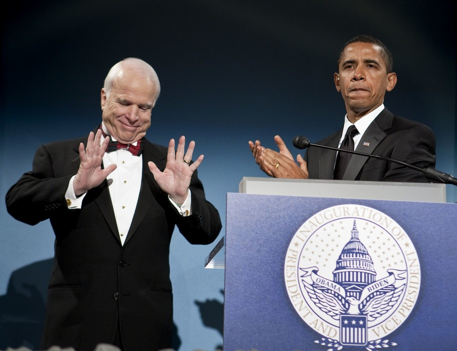 WASHINGTON - JANUARY 19:  President-elect Barack Obama introduces his former political rival Sen. John McCain (R-AZ) at a bipartisan dinner in the National Building Museum on January 19, 2009 in Washington, DC.  Inaugural events continue throughout the city before President-elect Barack Obama is to be sworn in as the 44th President of the United States on January 20, 2009.  (Photo by Joshua Roberts-Pool/Getty Images)