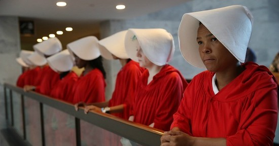 """Women dressed as handmaids from the TV series and Margaret Atwood novel """"The Handmaid's Tale"""" greeted Judge Brett Kavanaugh at his confirmation hearing to be named the next U.S. Supreme Court justice. Sept. 4, 2018"""