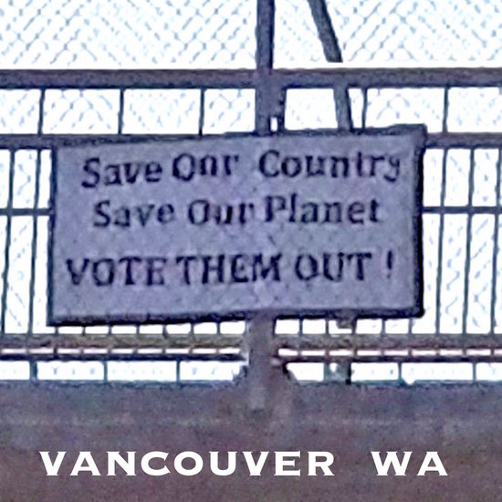 Save our country save our planet VOTE THEM OUT sign on overpass.
