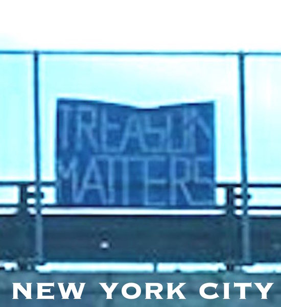 Treason Matters banner over Hwy
