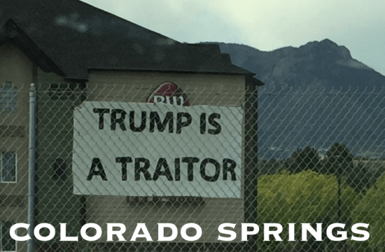 Trump is a Traitor sign next to I-25