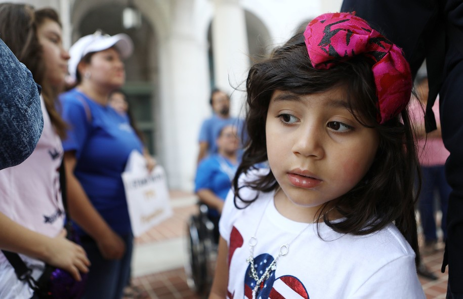 LOS ANGELES, CA - AUGUST 17: Ariely Murrilo (R), a U.S. citizen, stands near her mother Mily Rivas (2nd L), a TPS recipient from El Salvador, at the launch of the 'TPS Journey for Justice Caravan' outside City Hall on August 17, 2018 in Los Angeles, California. Mily faces deportation with the termination of the TPS program for Salvadorans. The caravan protests the Trump administration's termination of Temporary Protected Status- a federal program which protects 450,000 immigrants from certain countries from deportation. The caravan will travel from Los Angeles to Washington, DC with more than 50 current Temporary Protected Status (TPS) holders. (Photo by Mario Tama/Getty Images)