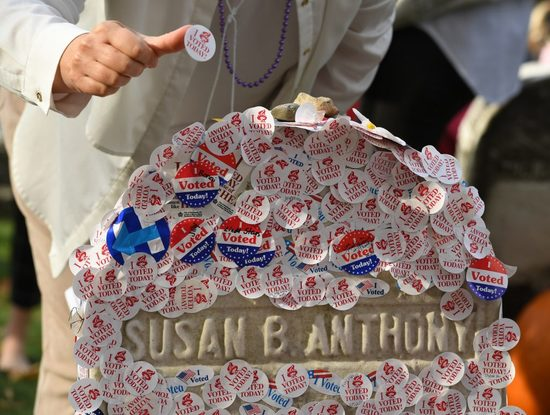 """Susan B. Anthony's grave with """"I voted"""" stickers plastered on it."""