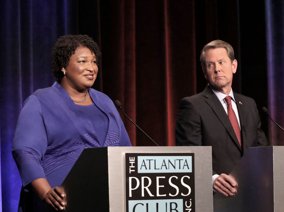 ATLANTA, GA - OCTOBER 23: Georgia gubernatorial candidates (L-R) Democrat Stacey Abrams and Republican Brian Kemp debate in an event that also included Libertarian Ted Metz at Georgia Public Broadcasting in Midtown October 23, 2018 in Atlanta, Georgia. (Photo by John Bazemore-Pool/Getty Images)