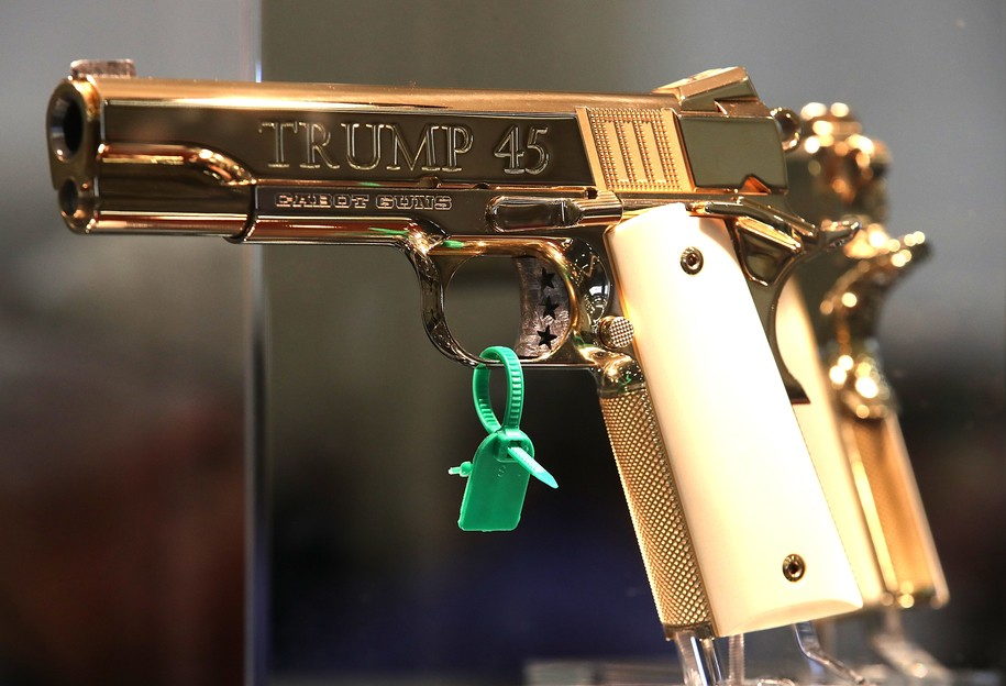 """DALLAS, TX - MAY 05:  A custom """"Trump 45"""" handgun is displayed during the NRA Annual Meeting & Exhibits at the Kay Bailey Hutchison Convention Center on May 5, 2018 in Dallas, Texas.  The National Rifle Association's annual meeting and exhibit runs through Sunday.  (Photo by Justin Sullivan/Getty Images)"""