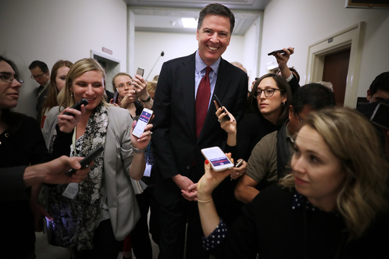 WASHINGTON, DC - DECEMBER 07: Former Federal Bureau of Investigation Director James Comey is surrounded by reporters after testifying to the House Judiciary and Oversight and Government Reform committees at the Rayburn House Office Building on Capitol Hill December 07, 2018 in Washington, DC. With less than a month of control of the committees, House Republicans subpoenaed Comey to testify behind closed doors about investigations into Hillary Clinton's email server and whether President Trump's campaign advisers colluded with the Russian government to steer the outcome of the 2016 presidential election. (Photo by Chip Somodevilla/Getty Images)