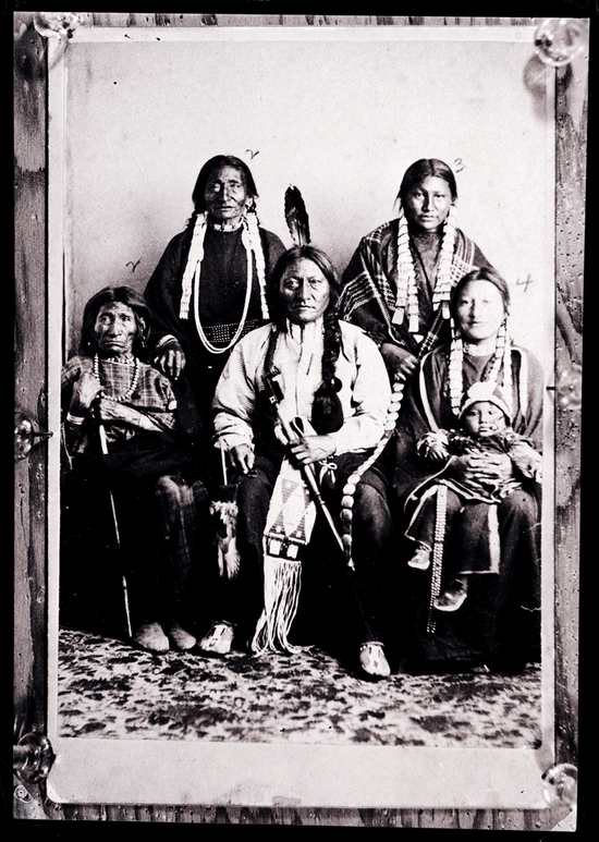 Sitting Bull's family posed for a portrait in 1883. Sitting Bull's mother is on his right, his daughter is on his left with her son in her lap. Behind Sitting Bull are his sister and his wife.
