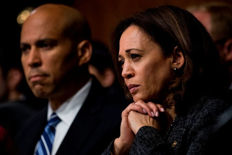 Sen. Cory Booker, D-NJ, and Sen. Kamala Harris, D-CA, listen during the Senate Judiciary Committee hearing on the nomination of Brett M. Kavanaugh to be an associate justice of the Supreme Court of the United States, focusing on allegations of sexual assault by Kavanaugh against Christine Blasey Ford in the early 1980s on September 27, 2018 in Washington,DC. (Photo by Tom Williams / POOL / AFP) (Photo credit should read TOM WILLIAMS/AFP/Getty Images)