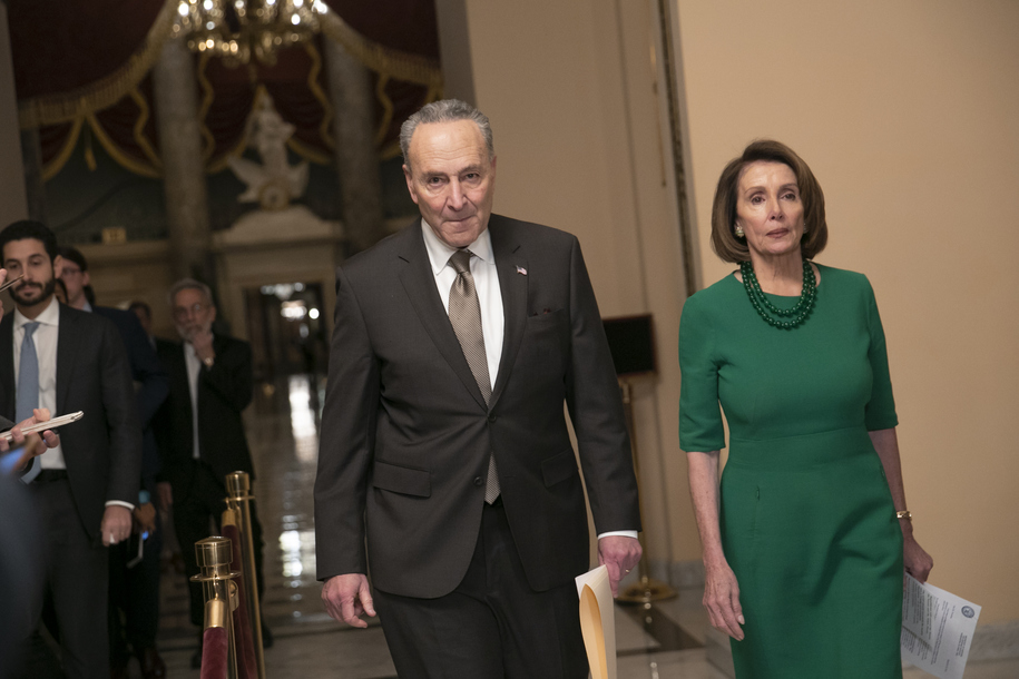 Senate Minority Leader Chuck Schumer, D-N.Y., and House Democratic Leader Nancy Pelosi of California, the speaker-designate for the new Congress, arrive to talk to reporters as a revised spending bill is introduced in the House that includes $5 billion demanded by President Donald Trump for a wall along the U.S.-Mexico border, as Congress tries to avert a partial shutdown, in Washington, Thursday, Dec. 20, 2018. (AP Photo/J. Scott Applewhite)