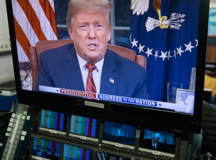 """US President Donald Trump appears on a television screen in the Press Briefing Room of the White House in Washington, DC, on January 8, 2019, as he speaks during a presidential address about the government shutdown and border security from the Oval Office. - Trump demanded $5.7 billion to fund a wall on the US-Mexico border in his first televised Oval Office address Tuesday, describing a """"growing crisis"""" of illegal immigration hurting millions of Americans. The president stopped short of calling for a much-touted state of emergency, instead appealing to the need to slash the cost of the illegal drug trade, which he put at $500 billion a year. """"There is a growing humanitarian and security crisis at our southern border. Every day customs and border patrol agents encounter thousands of illegal immigrants trying to enter our country,"""" Trump said. (Photo by SAUL LOEB / AFP) (Photo credit should read SAUL LOEB/AFP/Getty Images)"""
