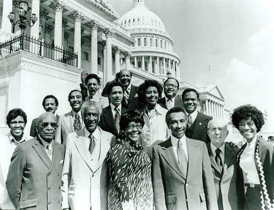 In 1977, 15 of the Congressional Black Caucus members posed on the steps of the U.S. Capitol, from left to right: (front row) Barbara Jordan of Texas, Robert Nix, Sr., of Pennsylvania, Ralph Metcalfe of Illinois, Cardiss Collins of Illinois, Parren Mitchell of Maryland, Gus Hawkins of California, Shirley Chisholm of New York; (middle row) John Conyers, Jr., of Michigan, Charles Rangel of New York, Harold Ford, Sr., of Tennessee, Yvonne Brathwaite Burke of California, Walter Fauntroy of the District of Columbia; (back row) Ronald Dellums of California, Louis Stokes of Ohio, and Charles C. Diggs, Jr., of Michigan.