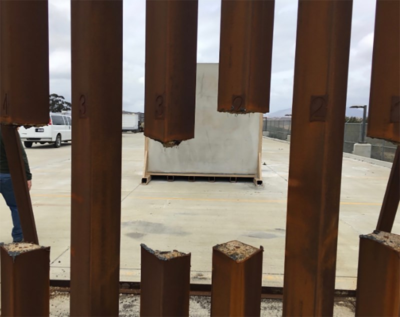 'Disgraceful misuse of taxpayer money' as U.S. troops along border spend their days painting a fence
